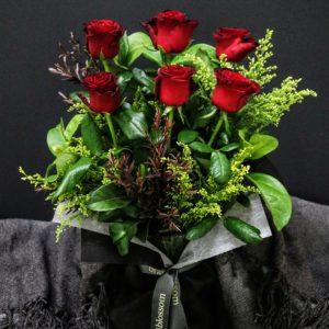 Halh a dozen Roses in a vase